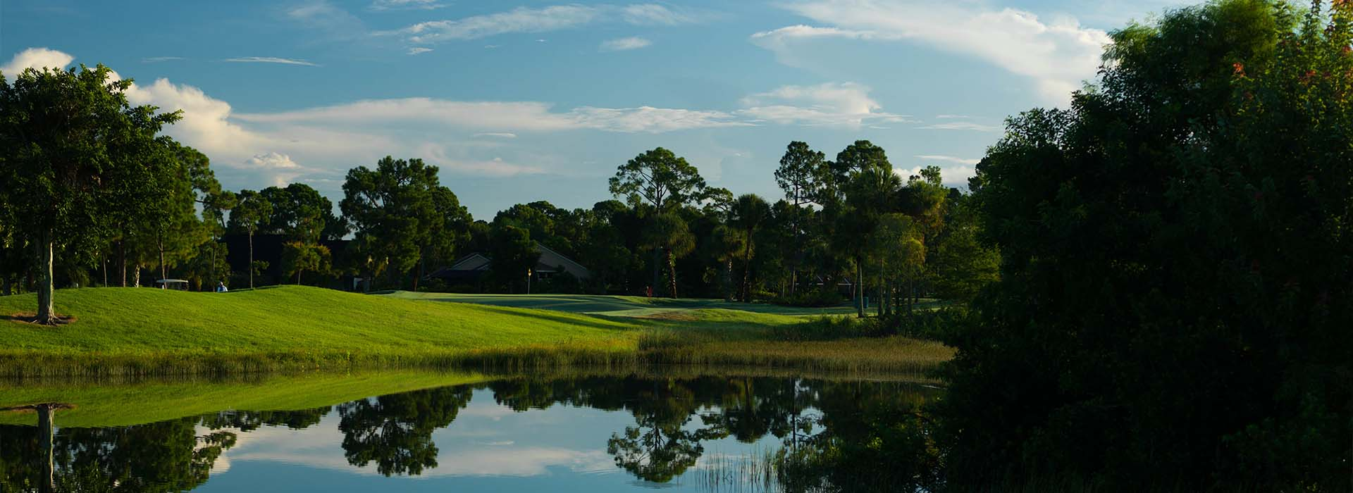 A hole at St. Lucie Trail Golf Club in Port St. Lucie is seen from across a lake