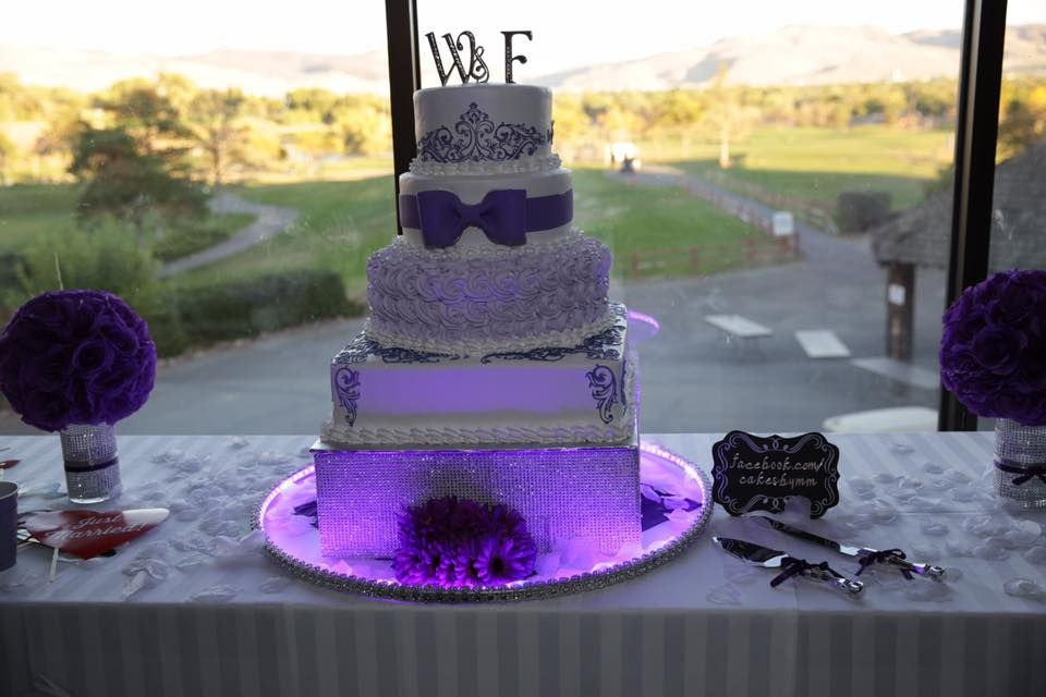 A wedding cake with purple accents
